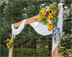 Blue and yellow sunflower floral arch at a backyard mountain wedding in Colorado. - April O'Hare Photography http://www.apriloharephotography.com