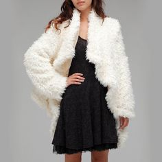 """Free People Cascading Sherpa Coat Make an offer! Super hard to find faux fur coat in white / cream by FP. It's surprisingly warm and thick. Slouchy and drapes elegantly like a cardigan. No closure, can be worn with belt. Worn a few times, in great condition. Fits S to M best. For reference, I am 5'3"""" and a size small! Free People Jackets & Coats"""