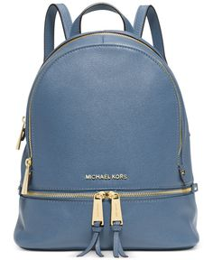 From the sidewalk to the catwalk, you won't want anything on your arm when you see this Michael Michael Kors backpack-it's right on-trend and oh-so-easy to tote.   Leather   Imported   Small sized bac