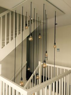 Beautiful hanging lamp in Vide staircase by Lichtbeurs Contemporary Interior Design, Modern House Design, Home Interior Design, Modern Stair Railing, Modern Stairs, Lobby Design, Rustic Chandelier, Interior Barn Doors, Home Decor Furniture