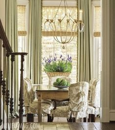 Drapes with natural blinds.  Toile with rustic table plus crystal in chandelier. I like!!!