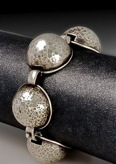 Domed bracelet-Cyd Rowley Sterling silver domed bracelet. dapped, fabricated, cast
