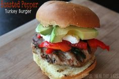A moist southwestern flavored turkey burger topped with roasted red peppers & poblano peppers.