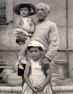 Pablo Picasso, 1951 with 2 of his 4 children, (mother was Francoise Gilot) Paloma (born, 1949) in his arms and Claude standing by his side (born,1947)