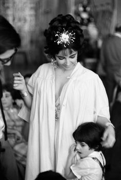 Not originally published in LIFE. During a break in the filming of Cleopatra, Elizabeth Taylor ruffles the hair of Liza Todd, her daughter with her third husband, Mike Todd.