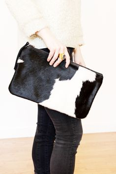This clutch is the perfect size for a day in the city or a night out. The brightly contrasted blocks of black and white add texture and visual interest to any outfit. www.mooreaseal.com