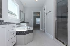 Transitional Master Bathroom - Note the penny round tile around the tub surround and shower accent