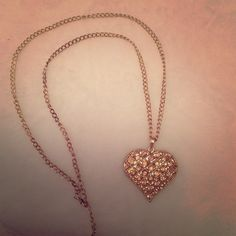 Heart shaped gold necklace Has slight pink faux diamonds in the heart pendant Icing Jewelry Necklaces Jewelry Necklaces, Gold Necklace, Heart Shapes, Icing, Diamonds, Shop My, Pendant, Womens Fashion, Closet