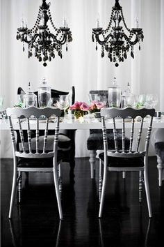 .Love the chandeliers and their placement...would place covers over the chairs for a more elegant look.