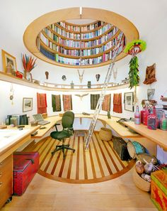 I love this home office with overhead library. Designed by Travis Price Architects. Not too keen on the decor though but the concept is fantastic.