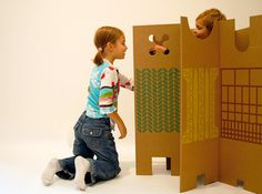 """Less is definitely more with this cardboard divider by legendary Italian designer Enzo Mari, who first brought the creative structure to life in the '60s. Dubbed """"Il Posto dei Giochi,"""" which translates to """"the place of the games,"""" the 10-foot-long corrugated sheet is composed of 10 panels, each with a different set of colored symbols, perforations, and shapes."""
