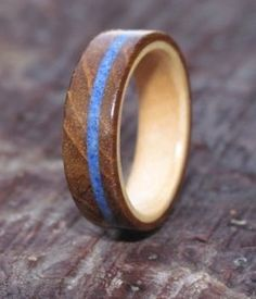This beautiful wooden ring has been  handcrafted from reclaimed Teak and Maple and would make a wonderful engagement ring www.wooden-rings.com
