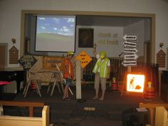 "Construction Zone VBS, lumber scraps, saw horses, snow fencing, borrowed a real ""men at work"" sign"