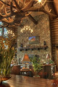 Look at that light fixture in the rustic cabin! What beautiful cabin decor!