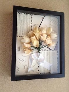 Preserve your wedding flowers and put them in a shadow box alongside with a cop of your invitations, announcements, menus, etc.