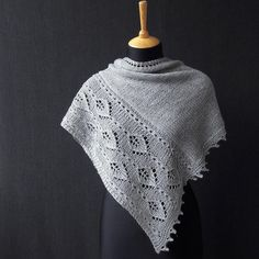 The shawl is designed as a slightly asymmetrical triangle. Worked from tip to tip, it grows into a triangular piece by increasing 1 st in the beginning of each RS row. The shawl is worked in stockinette stitch featuring lace outside panel. Find this pattern at LoveKnitting!