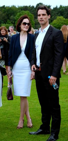 Very elegant public at the Queen s Cartier Cup at Guards Polo Club Michelle  Dockery 6863811198e7