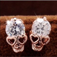 Skull Studs Small 18k gold plated skull earrings with CZ stones. So cute. New in package. Jewelry Earrings