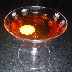 Grand Street  2 oz Beefeater Gin 1/2 oz Punt e Mes 1/4 oz Maraschino Liqueur 1/4 oz Cynar  Stir with ice and strain into a cocktail glass. Garnish with a grapefruit twist.