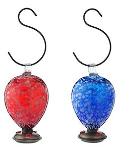 vibrant hummingbird feeders, handmade from recycled glass by artisans in Mexico.