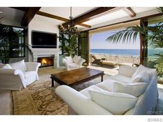 Oceanfront Living Room with Fireplace and view of the Beach