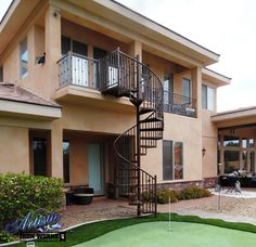 Wrought iron spiral stairs and balcony railings with knuckles