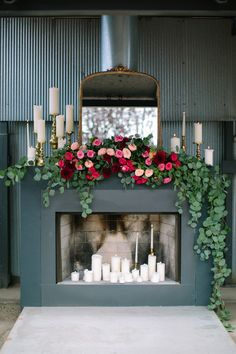 Beautiful fireplace display - flower arrangement with roses and eucalyptus - Candles - Photography: Kerinsa Marie  - www.kerinsamarie.com  Read More: http://www.stylemepretty.com/2014/06/10/gold-pink-wedding-inspiration/