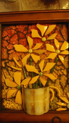 Poppins Mosaics and Crafts Cup tesserae flowers, half cup , fused stems on tempered glass background. <3 the temperd glass background