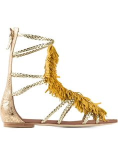 Visconti Et Du Reau Tasseled Gladiator Sandals Yellow leather tasseled gladiator sandals from Visconti Et Du Reau. Trovato su Styletorch