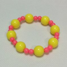 Mix Bubblegum Pearl Bracelet in Neon Yellow x Neon Pink from Pastel Skies - Lolita Desu Pearl Bracelet, Beaded Necklace, Beaded Bracelets, Pastel Sky, Neon Yellow, Lolita Fashion, Bubble Gum, Pearls, Pink