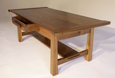 Hand made, custom Walnut Coffee Table designed and built by Josh from Offerman Woodshop. Walnut breadboard ends, hand cut dovetails on drawer. Made in USA.