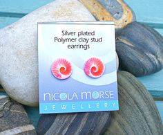 salmon swirl stud earrings - faux ceramic technique. http://www.nicolamorsejewellery.co.uk/ourshop/prod_2662719-Salmon-pink-faux-ceramic-stud-earrings.html