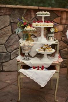 dessert display using vintage cake stands and linens - we still have Mom's old french tables like this!