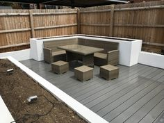 Grey composite decking with Rendered raised beds