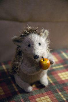 hedgehog holding an apple