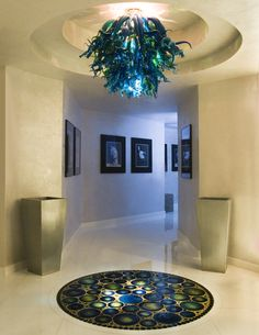 Custom designed entry way for a home in Miami, FL.  Over 500 pieces of glass were created by Seattle Glassblowing Studio for the installation.