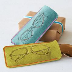 Soft Felt Spectacles Case :: I think they are machine embroidered, but I love the stylized motifs... It gives me ideas...