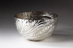 Beautiful work by Miriiam Hanid - Cross Flow Bowl - (12x12x9cm) - Hand raised sweet bowl. Chased with tidal motifs which merge into an oscillating design...
