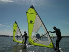 Group windsurf hire on a fantastic day out on the water, Poole Harbour.  All the latest equipment available at the Poole Windsurfing School. #windsurfhire #pooleharbour #poolewindsurfing