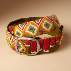 "CHIMERA BELT -- Magical, indeed, our bright wool belt is hand embroidered by artisans in Peru, transforming everything you wear it with. Exclusive. Sizes S (32""), M (34""), L (36""). 2""W."