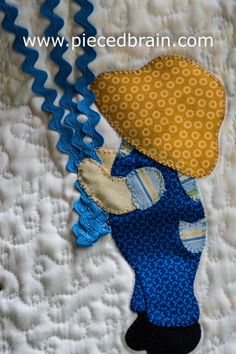 Kite wall hanging by Pieced Brain. The Sunbonnet Sue (Sam?) and dog came from the book 'Sunbonnet Sue and Scottie at Play' by Suzanne Zaruba Cirillo