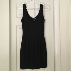 H&M little black dress Super simple LBD from H&M. Very stretchy and form fitting. Gathering at the waist gives a great shape. Size 4 H&M Dresses Mini