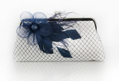 White Clutch with Navy Blue Feather Flower Fascinator