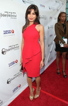 Freida Pinto kept her red carpet look classic and sophisticated with this one-shoulder red dress, featuring an angled ruffle that becomes the dress' slit. Brand: Rachel Roy