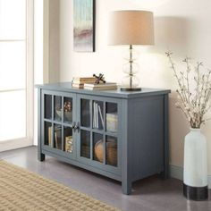 Better Homes and Gardens Oxford Square Blue TV Stand and Console Is Designed to Accommodate Flat Panels TVs up to up to 135 lbs