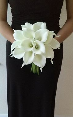 Elegant white Real Touch calla lily bridal bouquet. Handle is wrapped in white ribbon with a matching bow. *Calla lily and ribbon color can be customized, please contact me with any questions or special requests.  Ships in 2-3 weeks.   9 wide x 11 tall bridesmaid bouquet (shown in photo) with 24 mini calla lilies  11x 11tall bridal bouquet has 36 mini calla lilies   Thank you so much for visiting my page!  Michele