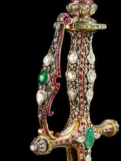 Ceremonial Sword 1880–1900 South India, Hyderabad Medium: Steel blade; gold hilt, inlaid with diamonds, rubies, and emeralds.