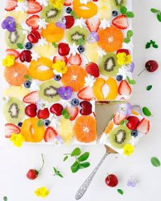 Fresh fruit & flower short cake. Vanilla sponge filled and topped with yogurt heavy cream and lots of fresh fruits and edible flowers.