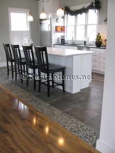 interesting transition between the tile & the wood floors. Google Image Result for www.stratastones....
