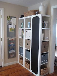 Cheap Decorating Ideas: Create a great organization center by lining up three Ikea Expedit shelving units. Turn the end unit 90 degrees and paint the side with chalkboard paint.